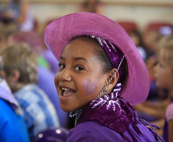 Kids Reach New Summits in Planning Purple Cake Day Events